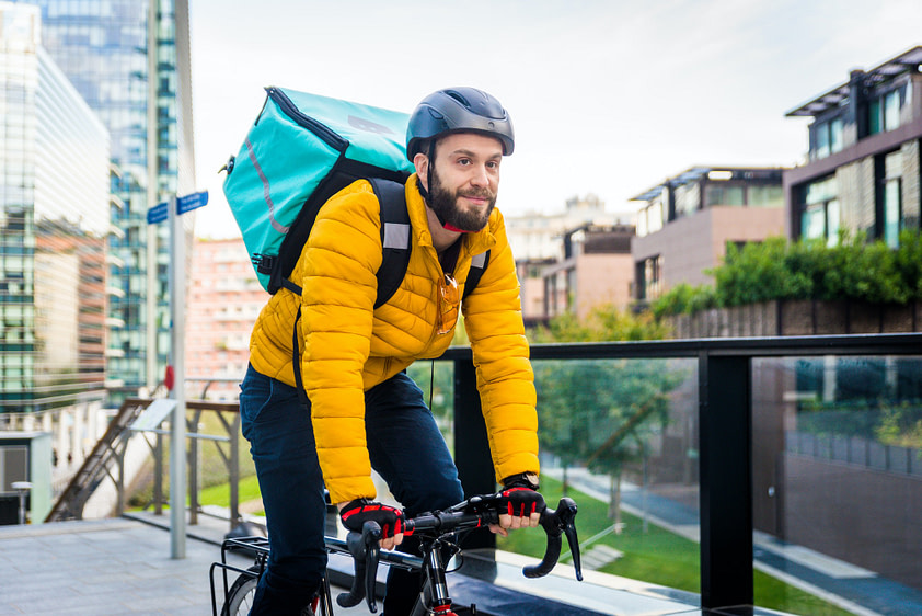 Food delivery, rider with bicycle delivering food
